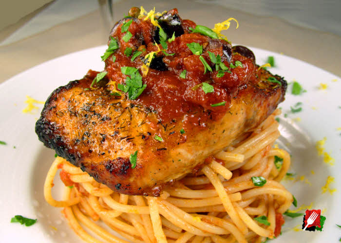 Grilled Salmon over Pasta Puttanesca