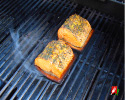 Salmon on Grill Starting to Flame