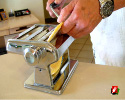 Insert dough into pasta maker at largest setting