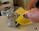 With the ends fully combined, continue to quickly run the pasta through the machine