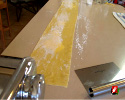 The finished 4 ounce piece of pasta about 3 1/2 feet long