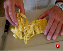 Breaking up the pasta noodles