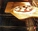 Slide Prepared Pizza Onto Pizza Stone