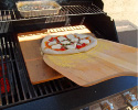Place Pizza on a Preheated Pizza Stone and Bake for 5 Minutes