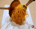 Continue to twist as you lean the spoon to deliver the pasta nest to the plate