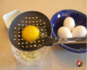 Strain eggs over bowl