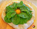 Top with spinach and an egg, then back in the oven for another 5-to-7 minutes
