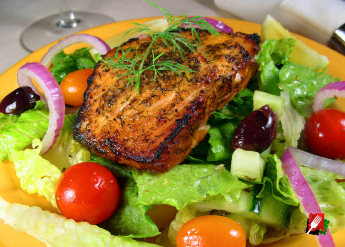 Grilled Salmon over Greek Salad