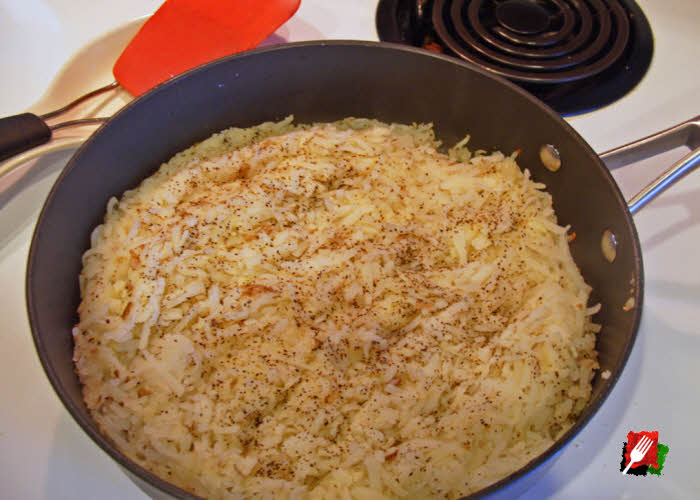 Add oil and shredded potatoes to pan over medium-high heat