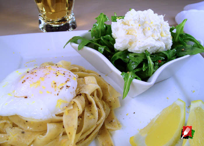 Lemon Pepper Pasta with Poached Egg and Arugula topped with Burrata