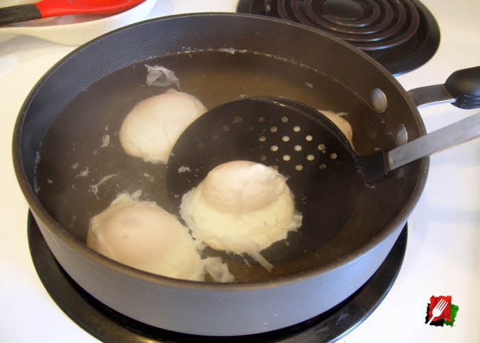 Use a slotted spoon to gently remove the poached eggs when done